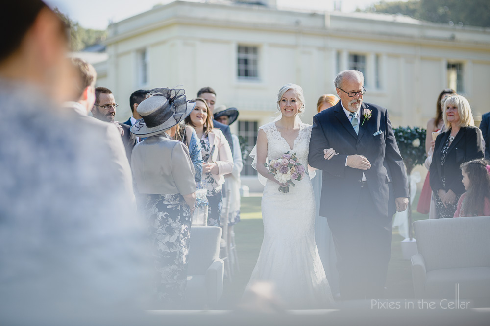 bride and dad down aisle outdoor ceremony