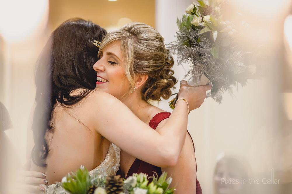 bride bridesmaid hug