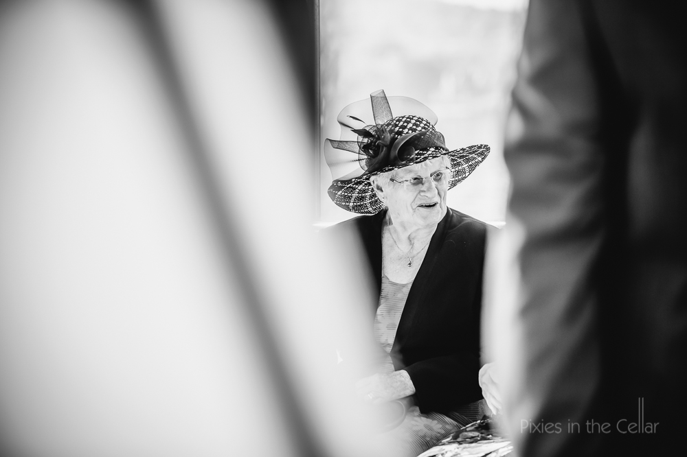 wedding guest in hat