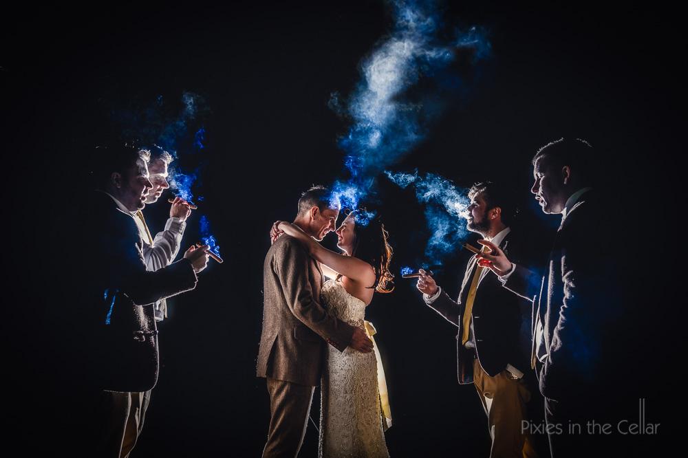 cigar smoke and bride and groom