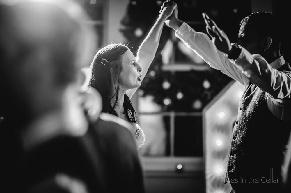 bride groom dancing arms in air