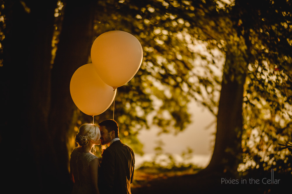 golden sun balloons bride and groom