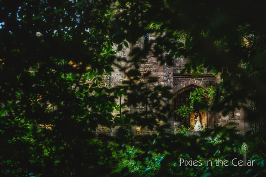 Peckforton castle through the trees