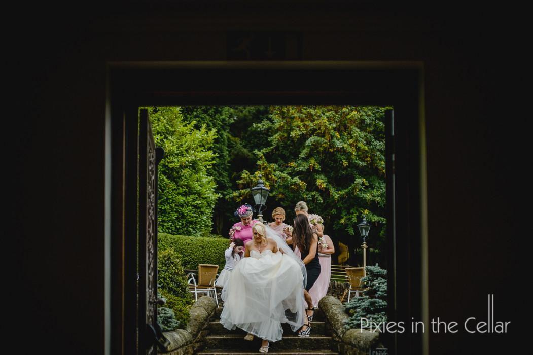 rainy wedding bride arrives