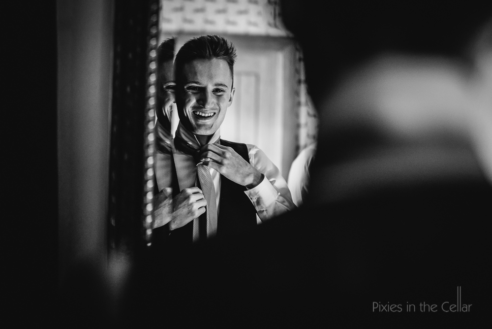 groom and tie in mirror