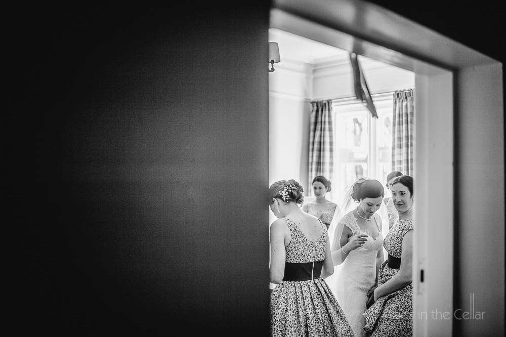 bride and bridesmaids through doorway