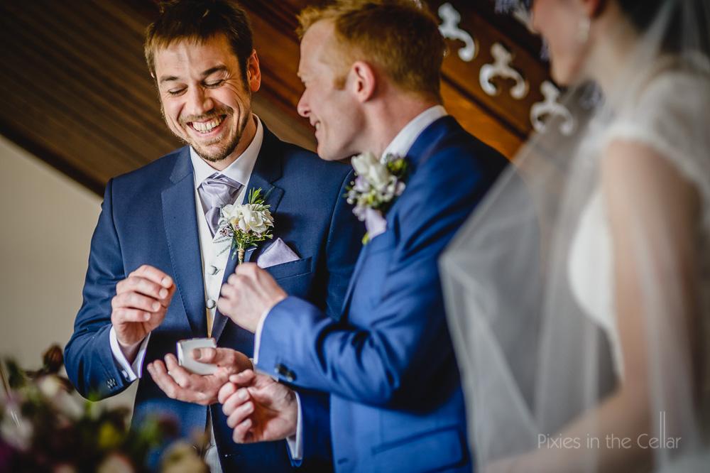 best man handing over wedding rings