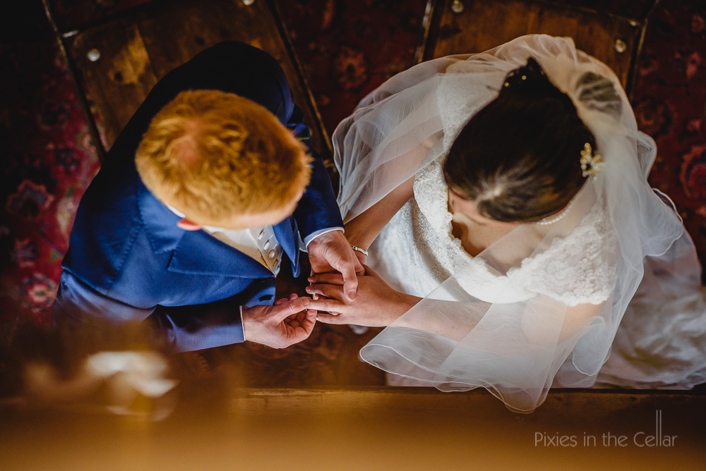 exchange of wedding rings, two photographers different angles