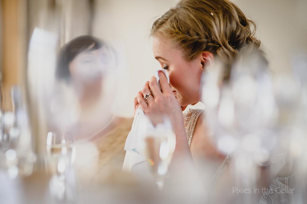 Mythe Barn wedding photographer bride during speeches
