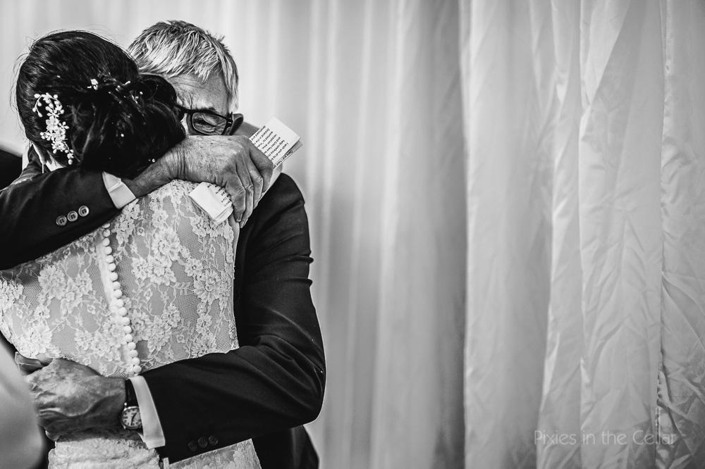 bride and dad emotion hug