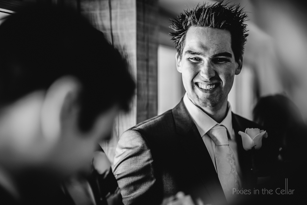 happy groom at wedding