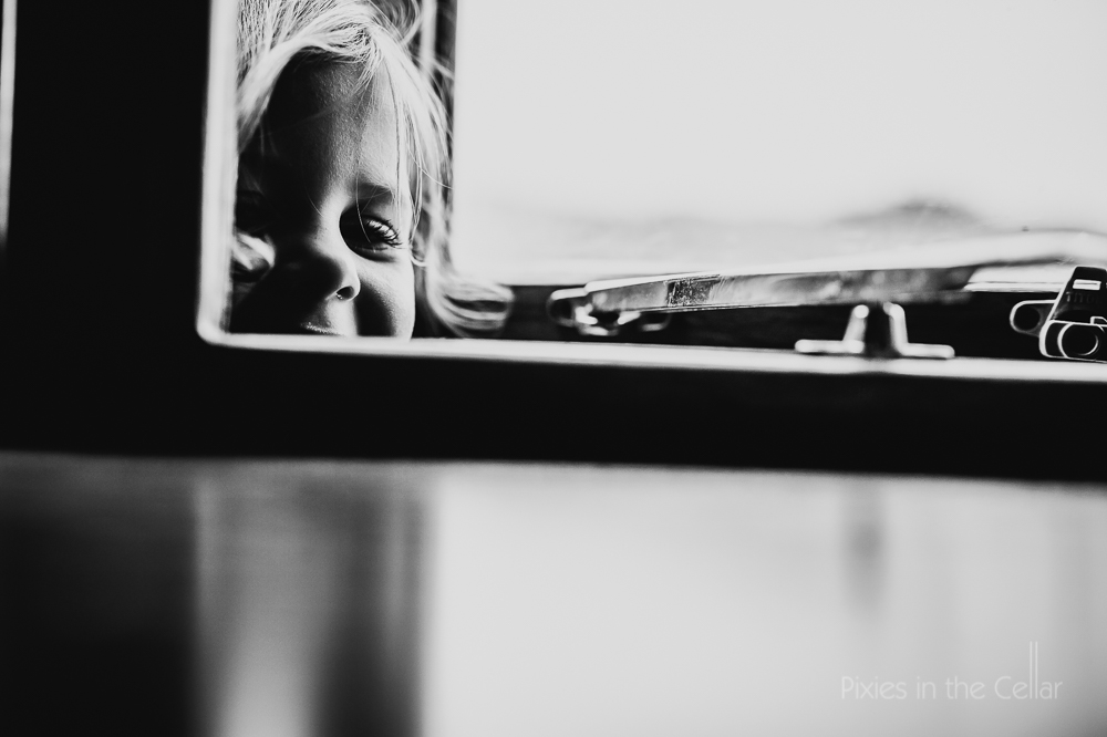 girl looking through window