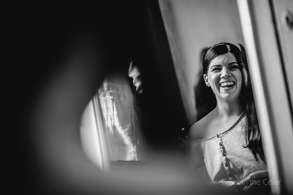 bridal prep in mirror