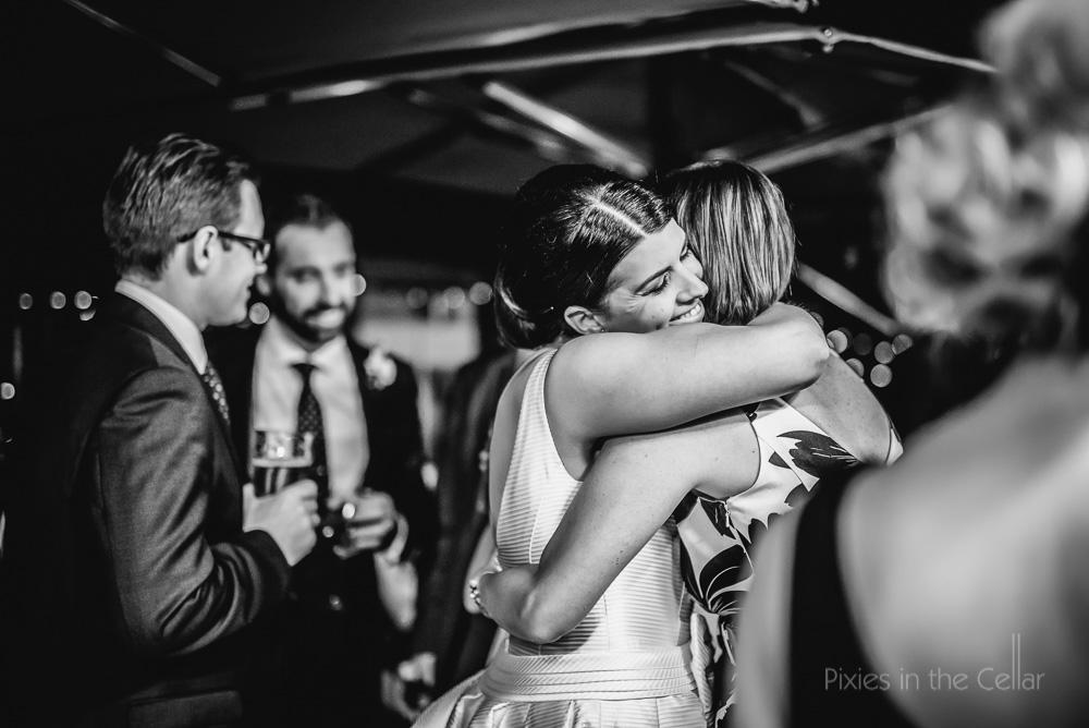 happy bride hugging guests