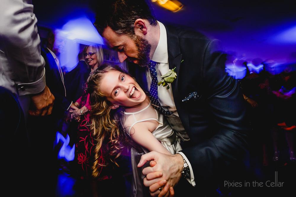 groom and flower girl dancing
