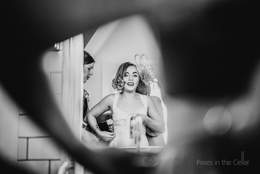 bride in mirror final touches