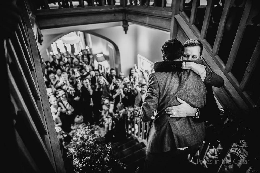 groom best man hug after wedding speeches