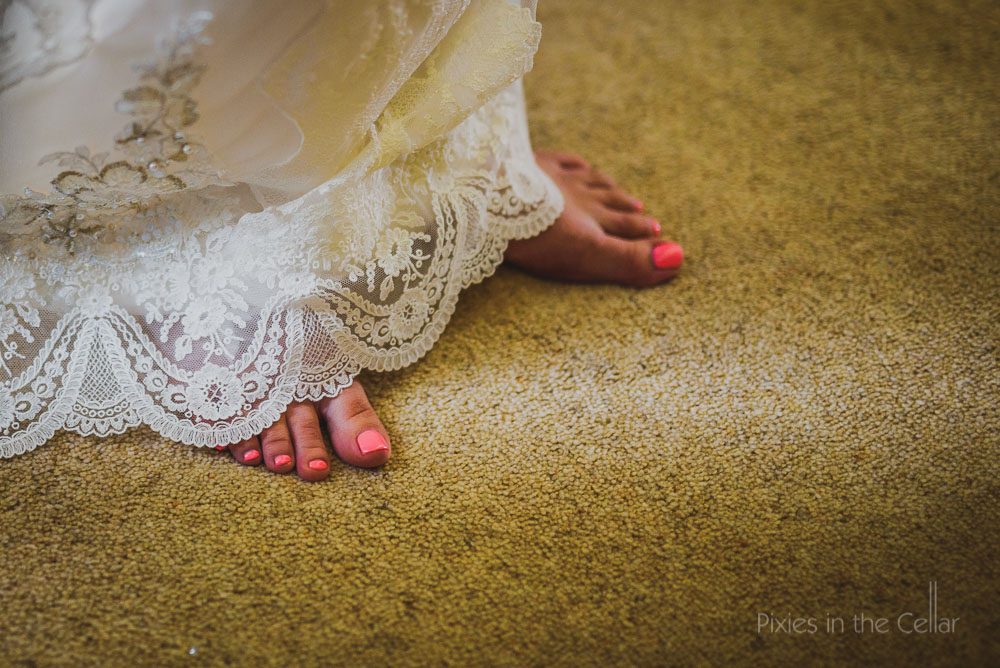 lace wedding dress and toes