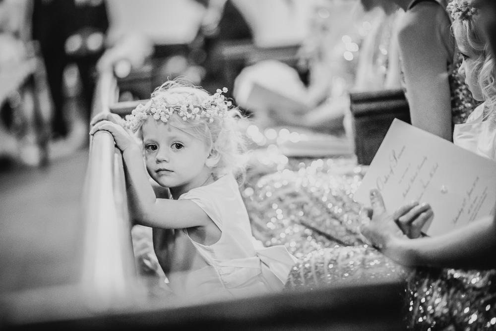 wedding flower girl church pew