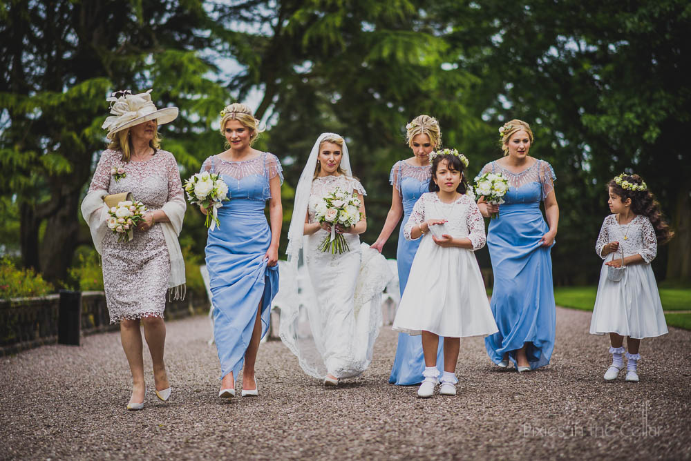 bride and bridesmaids walking to chapel at Capesthorne Hall
