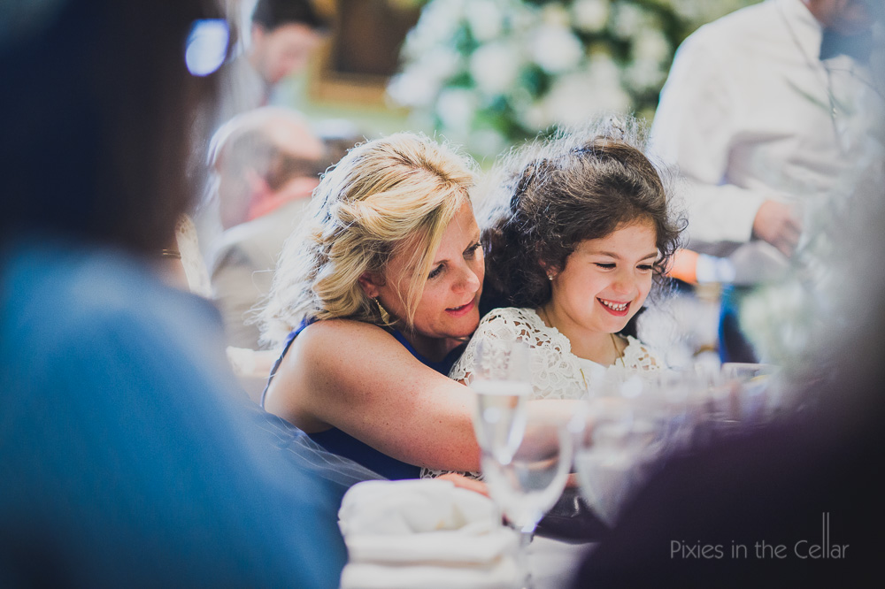 wedding guest and flower girl at table
