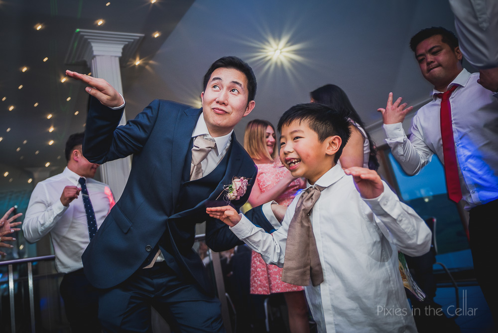 groom and boy dancing