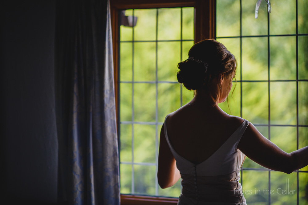 pensive bride in window