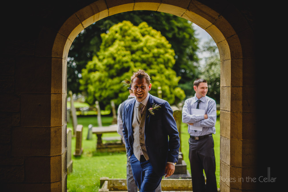 groom in church archway