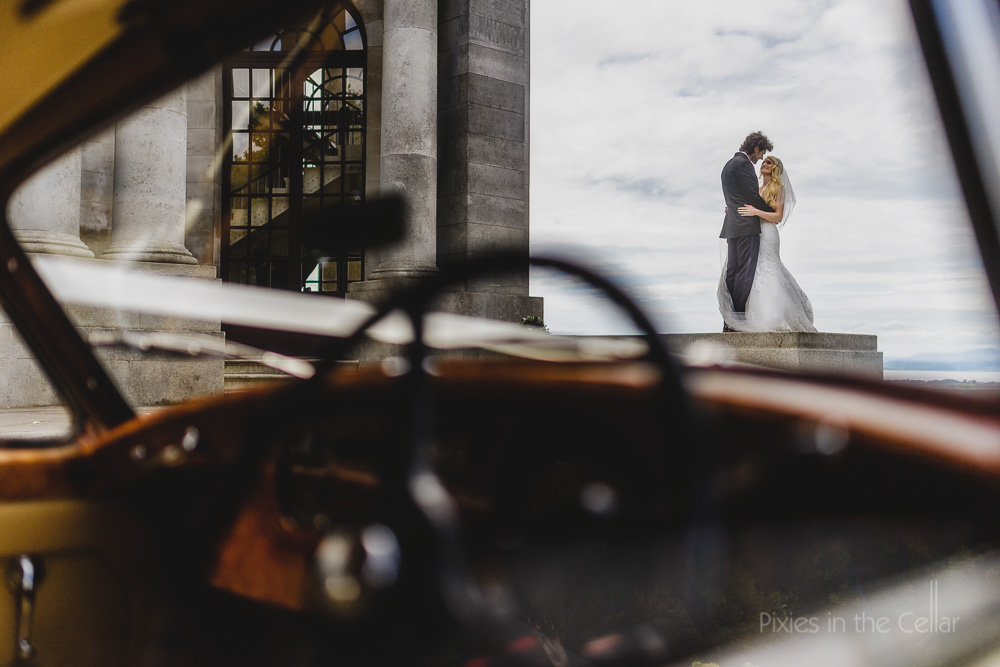 bride groom and wedding car