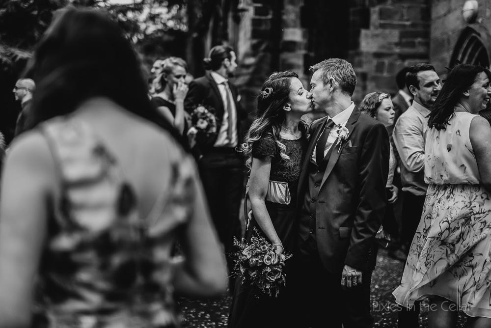 wedding guests kiss