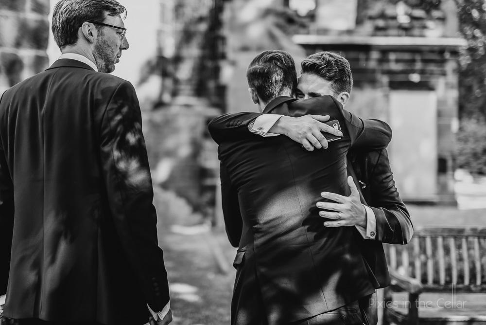 groomsmen hugs