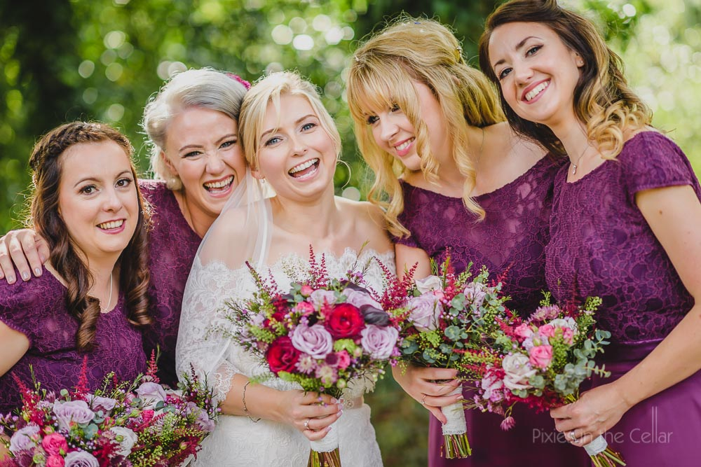 bride and purple bridesmaids