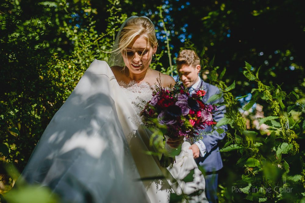 bride and groom portraits through the undergrowth