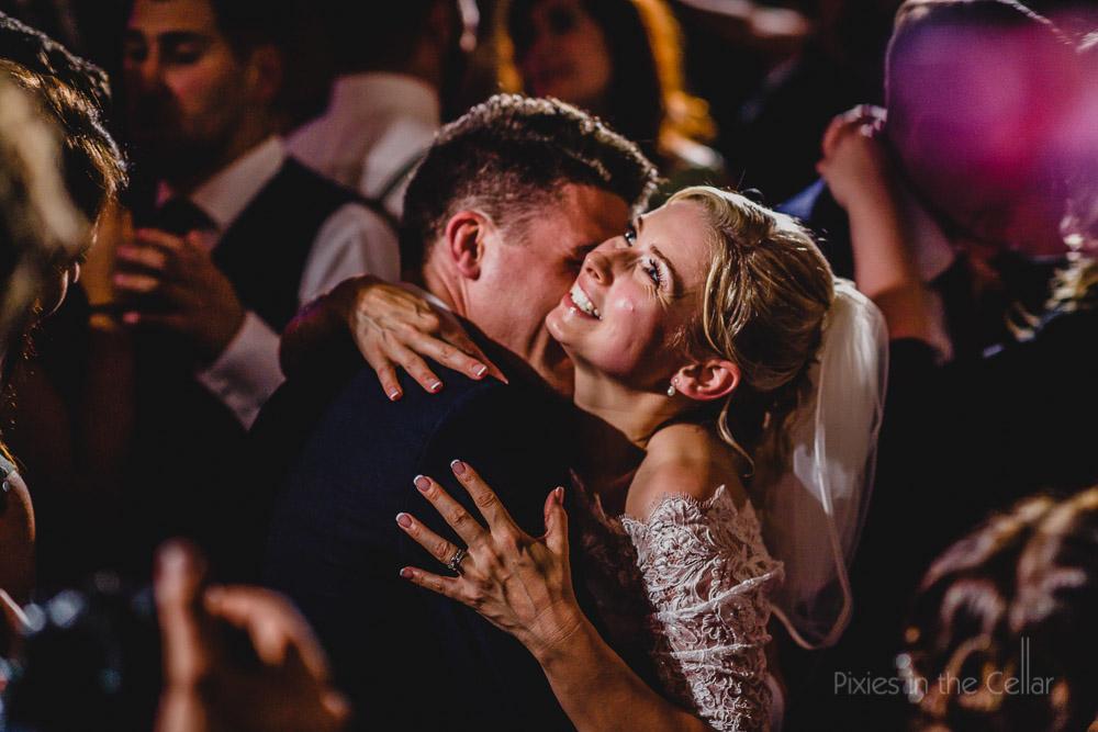 bride groom dancing hug
