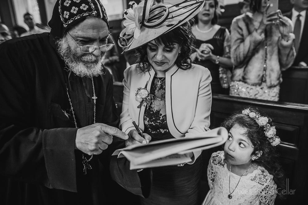 UK coptic wedding ceremony signing the book
