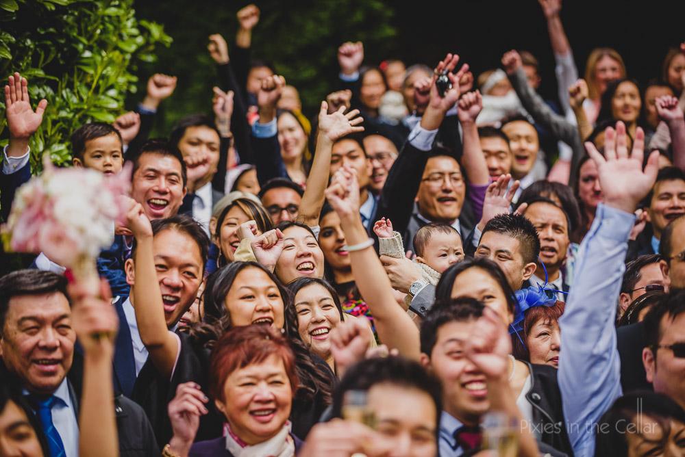 chinese wedding crowd cheering