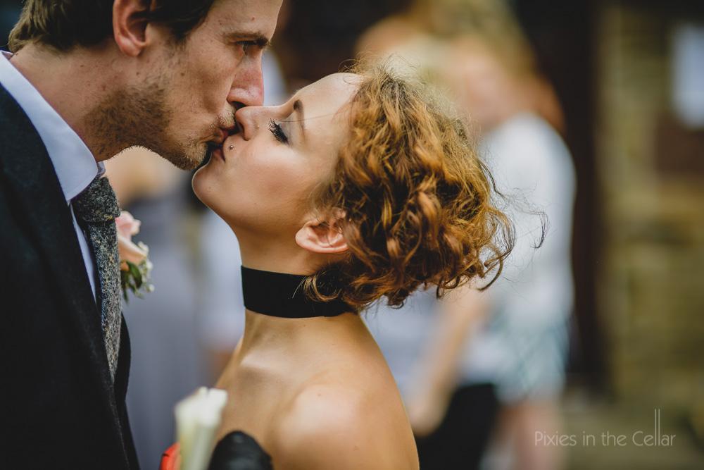 wedding guests kissing