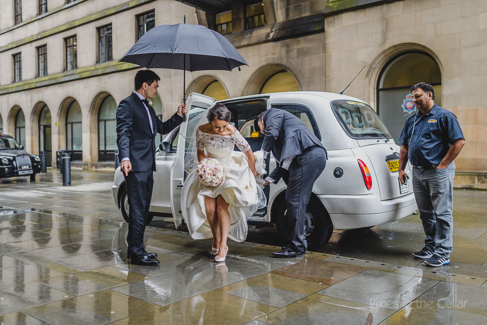 manchester rainy wedding arrival of bride
