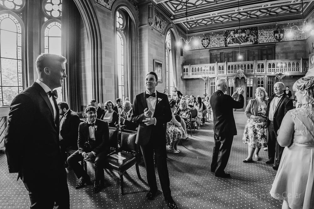 Manchester town hall groom waiting for bride black and white