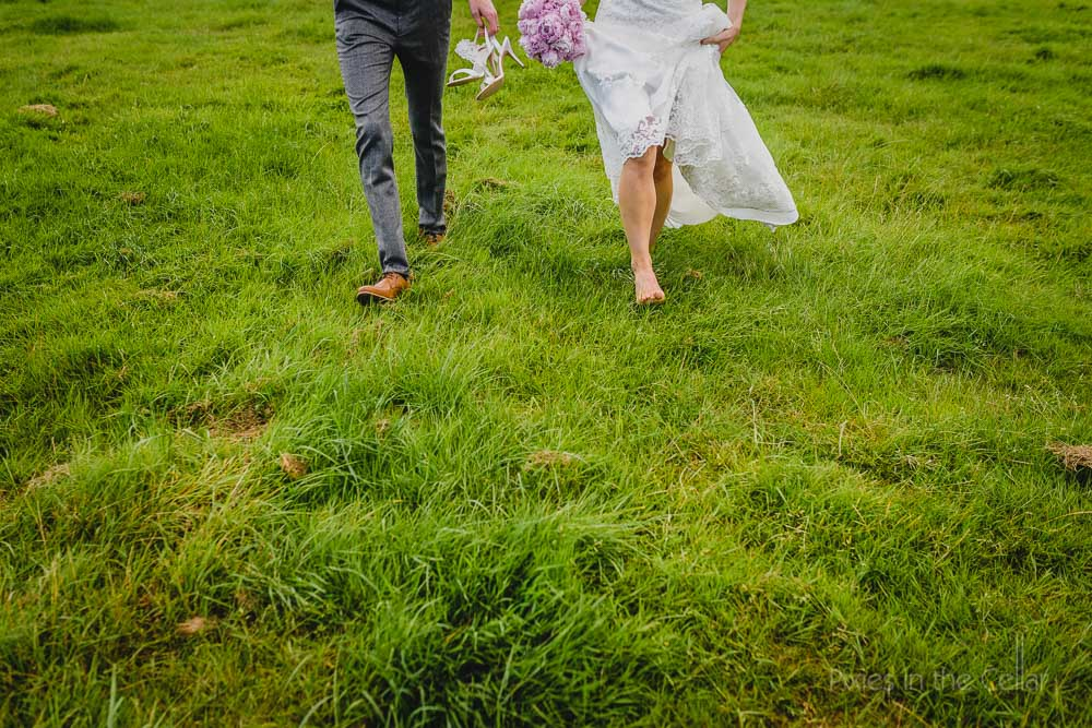 owen house wedding barn bride groom feet in field