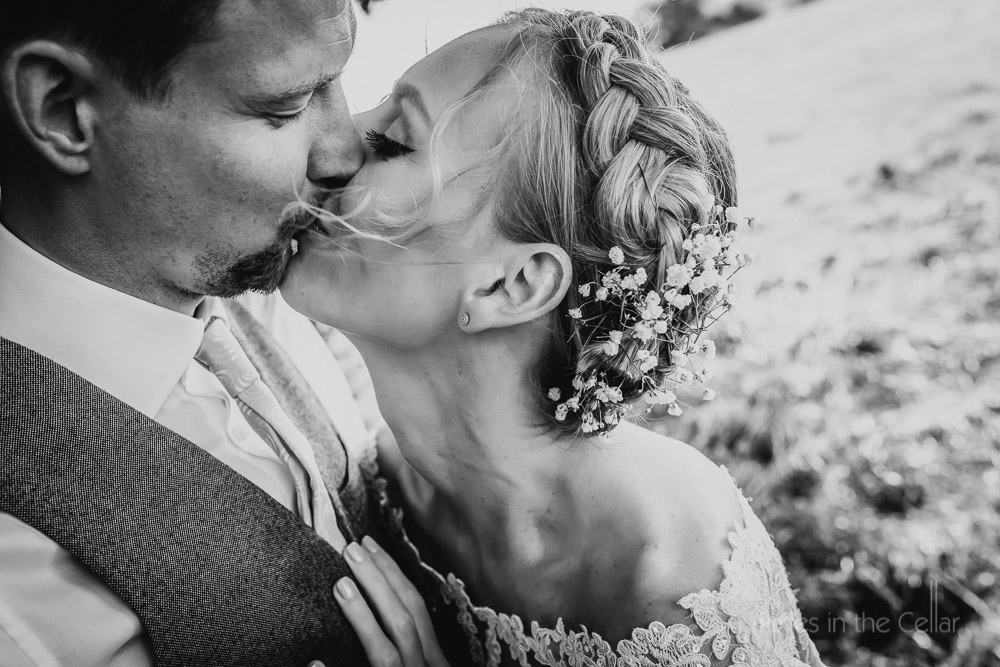 bride and groom kissing black and white image