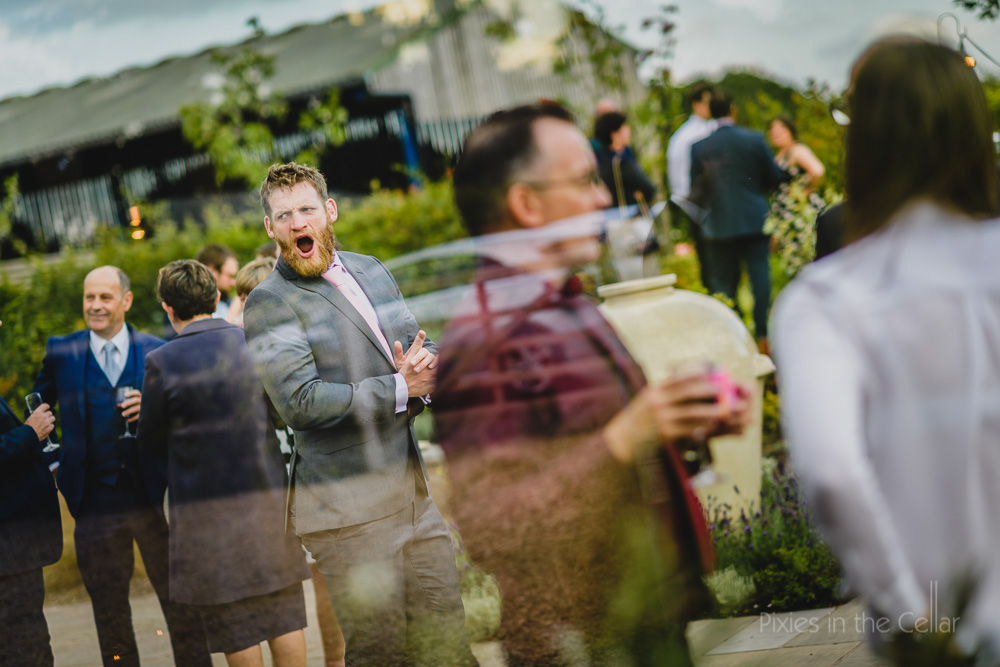 yawning guest at wedding