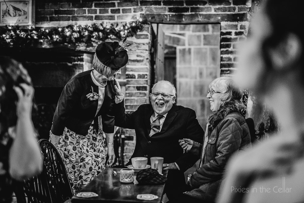 the abbey pub darley mill wedding guests laughing