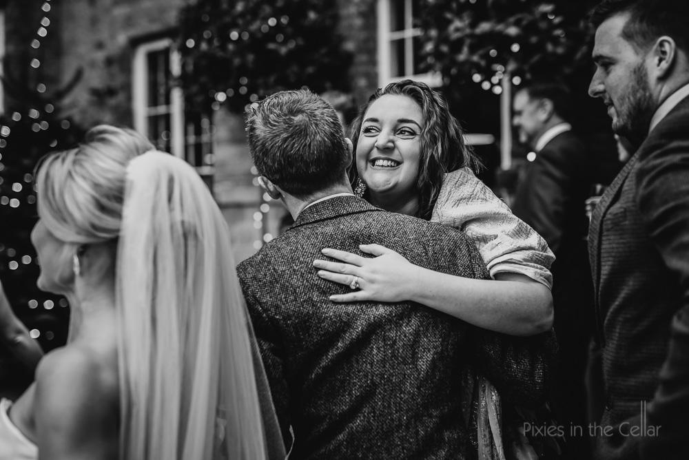 wedding friends hugging