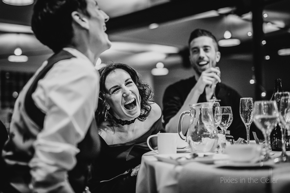 laughing happy wedding guests