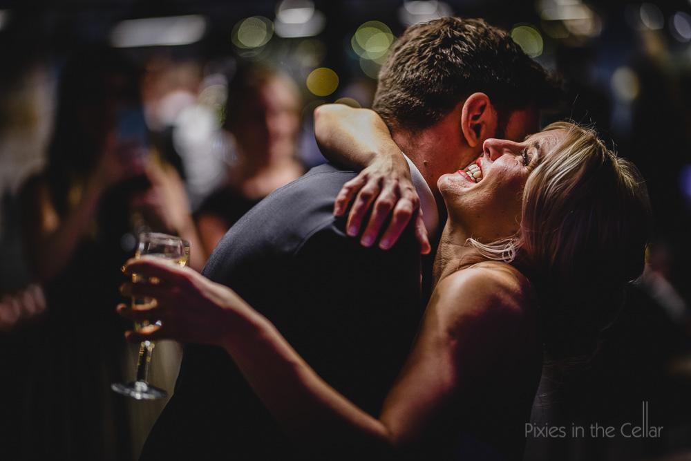 happy bride hugs uk wedding photography