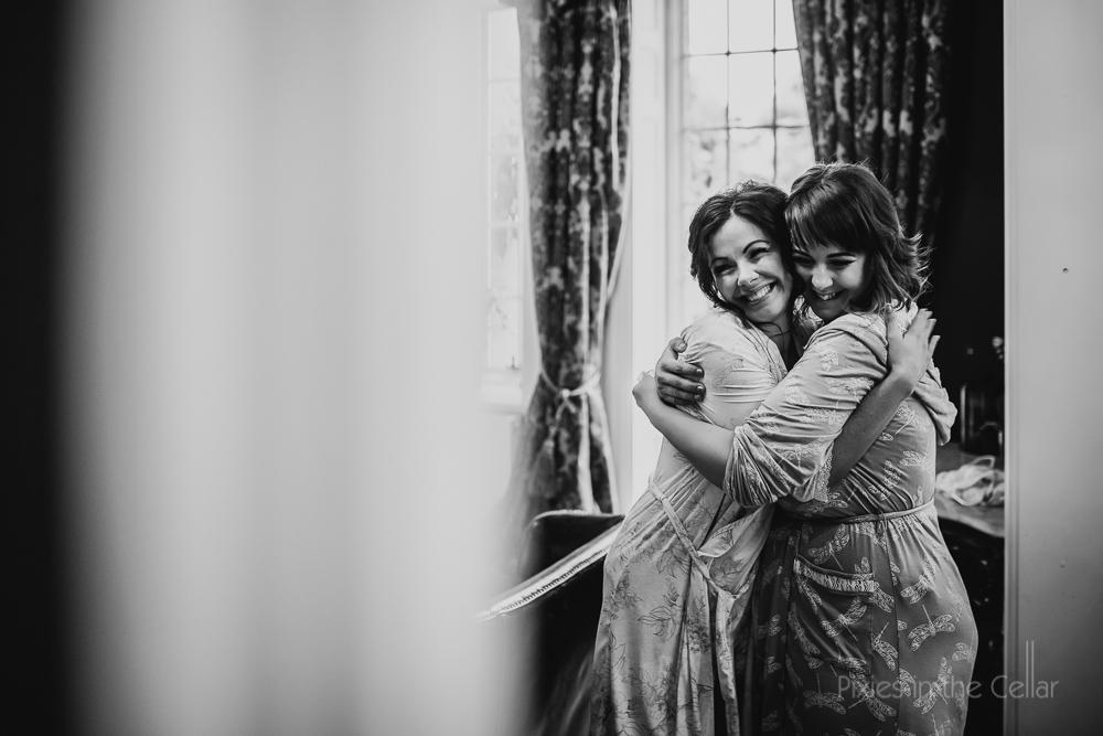 bride and bridesmaid friend hugs smiles