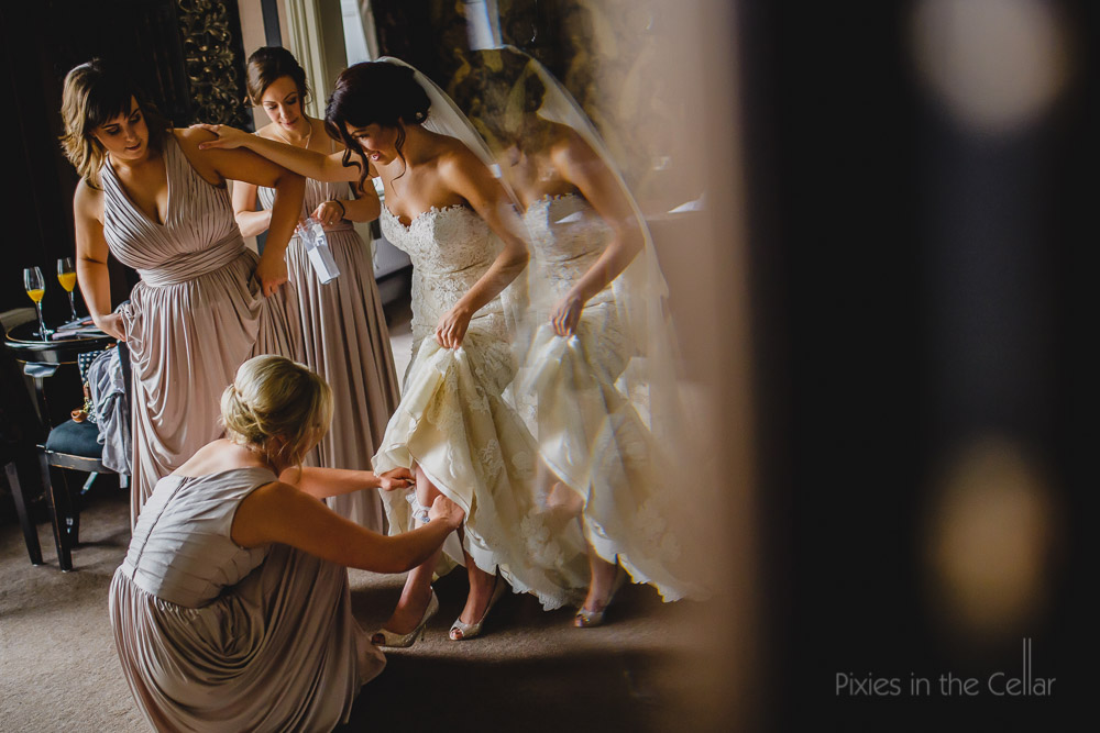balancing for that garter moment bride