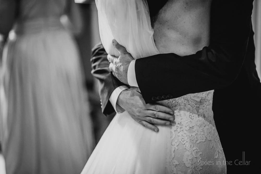 dad and bride hug