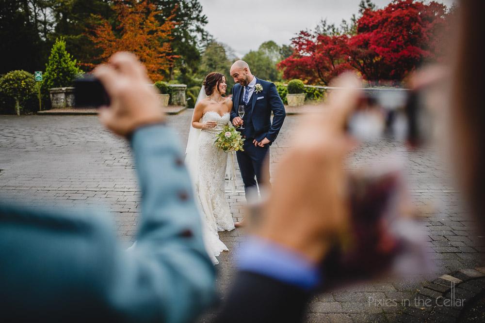 bride and groom guests cameras